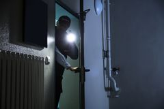 Male Security Guard Searching With Flashlight stock photo