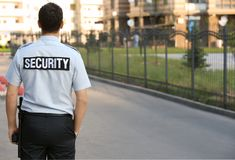 Male security guard standing. Outdoors Royalty Free Stock Photos