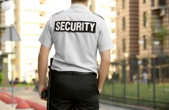 Male security guard standing. Outdoors Stock Photography