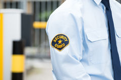 Male Security Guard In Uniform. Close-up Of A Male Security Guard In Uniform Royalty Free Stock Photography