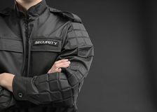Male security guard in uniform on dark background. Closeup Royalty Free Stock Photo