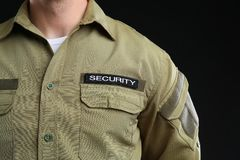 Male security guard in uniform on dark background. Closeup Royalty Free Stock Photos