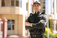 Male security guard in uniform outdoors. Portrait of male security guard in uniform outdoors Royalty Free Stock Images