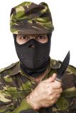 Male self defense instructor with camouflage do a self defense. Exercise with knife, isolated on white background stock photo