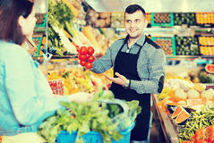 Male seller assisting in buying Royalty Free Stock Images