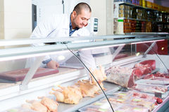 Male seller in halal section at supermarket. Portrait of male seller in halal section at supermarket Stock Photography