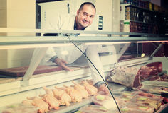 Male seller in halal section at supermarket Stock Image