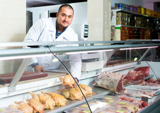 Male seller in halal section at supermarket. Portrait of happy male seller in halal section at supermarket Stock Photography