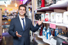 Male seller at household appliances section Stock Photography
