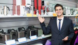 Male seller at household appliances section Royalty Free Stock Photo
