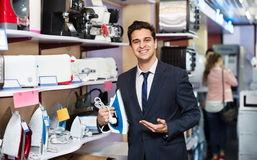 Male seller at household appliances section Royalty Free Stock Photos