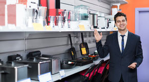 Male seller at household appliances section Royalty Free Stock Photography