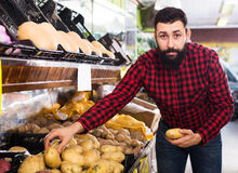 male seller moving fresh vegetables stock photography