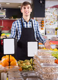 Male seller posing in fruits store Royalty Free Stock Image
