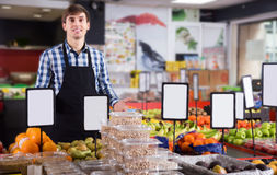 Male seller posing in fruits store Stock Photo
