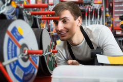 Male seller posing at tooling section. Happy male seller posing at tooling section of household shop Stock Images