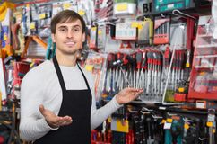 Male seller posing at tooling section Stock Photos