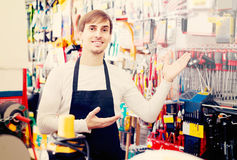 Male seller posing at tooling section of household store Stock Photos