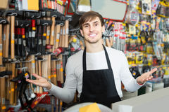Male seller posing at tooling section of household store Stock Images