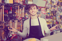 Male seller posing at tooling section of household store Royalty Free Stock Photos