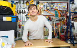Male seller posing at tooling section Royalty Free Stock Image