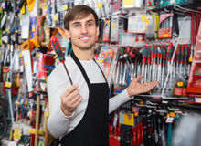 Male seller posing at tooling section Stock Photography