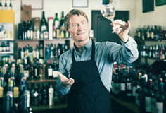 Male seller promoting to try wine before purchasing Royalty Free Stock Photo