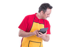 Male seller using a digital tablet. To count the product in the store isolated on white background Stock Photography