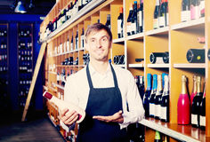 Male seller in wine store Royalty Free Stock Photos