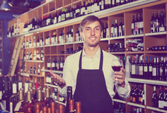 Male seller in wine store Royalty Free Stock Image