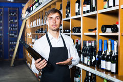 Male seller in wine store Royalty Free Stock Images