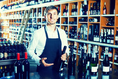 Male seller in wine store Stock Images