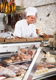 Male seller working at meat market Royalty Free Stock Photography