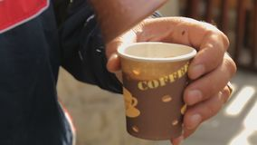 Male selling coffee in the street, small business, national warm hospitality. Stock footage stock footage