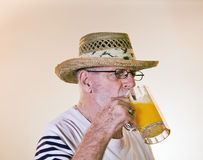 Male Senior Drinking Beer Stock Photos