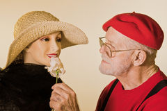 Male Senior Flirting With A Mannequin Royalty Free Stock Photo