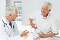 Male senior patient visiting a doctor Stock Photo