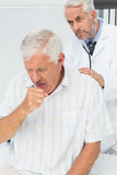 Male senior patient visiting a doctor stock images