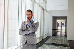 Male serious government worker in luxury suit is standing in modern interior before conference stock photos