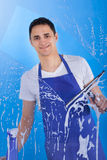 Male Servant Cleaning Glass With Squeegee Stock Photos