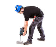 Male serviceman. With hammer drill Stock Photo