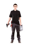 Male serviceman. With toolbox and power drill Stock Photos