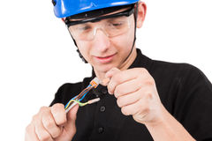 Male serviceman. Working with cables Stock Images