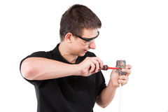 Male serviceman. Working with cables and electrical outlet Royalty Free Stock Image