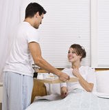 Male serving female breakfast in bed Royalty Free Stock Image