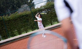 Male serving at tennis Stock Photo