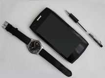 Male set, black pen, smartphone and clock. On white background Royalty Free Stock Photos
