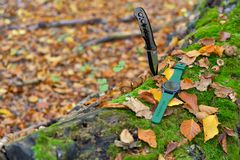 Male set - knives and watches. Black knife and smart watch in au. Tumn forrest Stock Photos