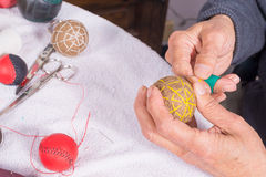 Male sewing sport balls Stock Photos
