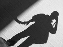Male shadow. On the road Stock Photography